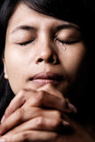 Praying and crying Stock Photos