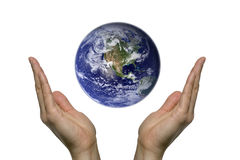 Praying for earth 1. Two hands praying for our blue earth Stock Photography