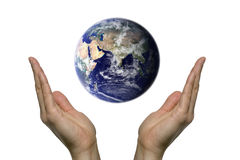 Praying for earth 2. Two hands praying for our blue earth Stock Image