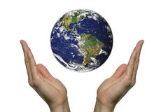 Praying for earth 3. Two hands praying for our blue earth Stock Photography