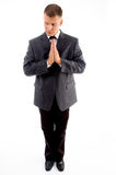 Praying executive looking sideways Stock Photo