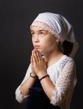 Praying fêmea novo bonito imagem de stock