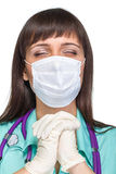 Praying female medical doctor with mask isolated Stock Images