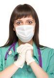 Praying female medical doctor with mask isolated Stock Image