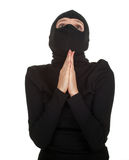 Praying female thief Royalty Free Stock Photos
