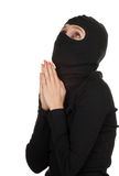 Praying female thief Stock Image