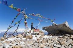 Buddha on mountain summit Nepal. Praying flags and buddha in Nepal trek summit Royalty Free Stock Images