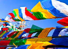 Praying flags floating in the wind Royalty Free Stock Images