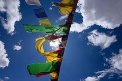 Praying flags floating in the wind Stock Images