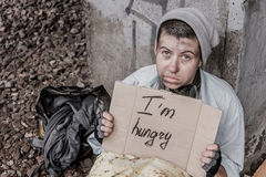 Praying for food. Homeless woman holding sign asking for food stock images