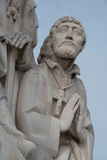 Praying friar. Detail of a marble monument depicting a monk Royalty Free Stock Photos