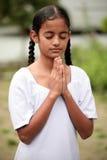 Praying girl. Indian girl praying to God Stock Photography