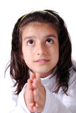 Praying girl. A young teenage girl praying and looking upwards with expectancy from above Stock Images