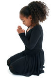 Praying Girl. A cute little girl in a praying pose, on white studio background Royalty Free Stock Photos