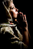 Praying girl with shawl on head. Retouched Stock Images