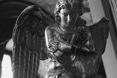 Praying gold angel (fragment) Royalty Free Stock Photo