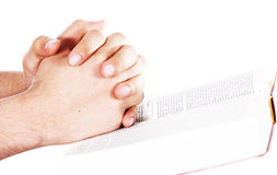 Praying hand on an Open bible Stock Photography