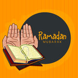 Praying hand and Quran Shareef for Ramadan Kareem. Stock Photo