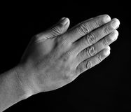 Praying hands. On black background Royalty Free Stock Image