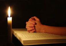 Praying hands. On  open bible Royalty Free Stock Photography