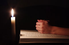 Praying hands. On  open bible Stock Photo