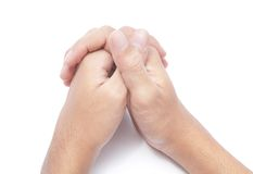 Praying hands. Two hands folded in prayer. Isolated over white Royalty Free Stock Photos