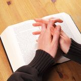 Praying hands. And book showing christian religion concept stock photo