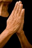 Praying hands. An old asian woman holds her hands in prayer Stock Image