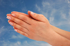 Praying Hands. Against blue sky royalty free stock photo