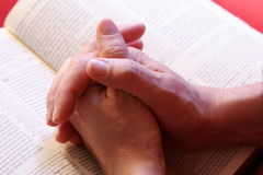 Praying hands Stock Images