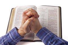 Praying hands. Over open bible stock photos