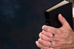 Praying Hands With Bible Stock Images