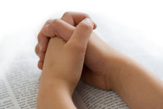 Praying hands on bible Stock Photography