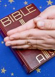 Praying hands and a bible Royalty Free Stock Images