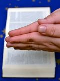 Praying hands and a bible Royalty Free Stock Image