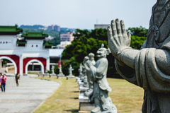 Praying hands. The hands of a budist statue Royalty Free Stock Image