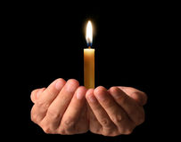 Praying Hands with candle. Man Praying Hands with candle Royalty Free Stock Images