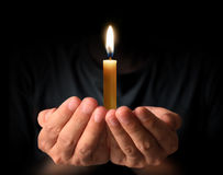 Praying Hands with candle. Man Praying Hands with candle Stock Photography