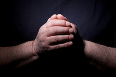 Praying hands closeup Stock Images
