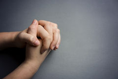 Praying Hands. On a Grey Background royalty free stock photos