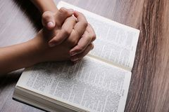 Praying Hands With Holy Bible stock photo