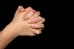 Praying hands isolated on black. Background Royalty Free Stock Image