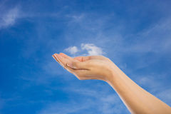 Praying Hands Isolated on sky background. Stock Photo