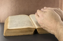 Praying hands and old bible Stock Images