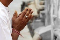 Praying hands. Of an old Indian man stock photos