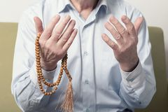 Praying hands of an old man Stock Images