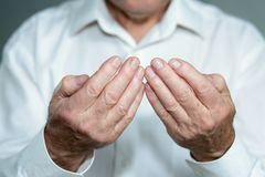 Praying hands of an old man Stock Photography