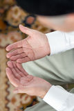Praying hands of an old man Royalty Free Stock Photo