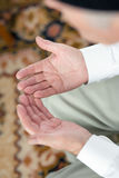 Praying hands of an old man Royalty Free Stock Images