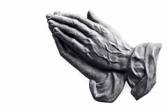 The praying hands of an old woman. Made of metal Stock Photography